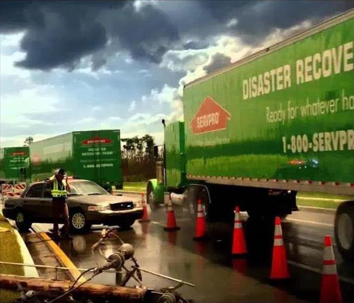 Green SERVPRO truck onsite at a large loss destination