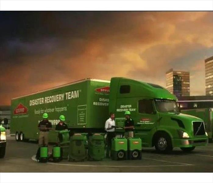 SERVPRO Disaster Recovery 18 Wheeler and 4 men standing beside it